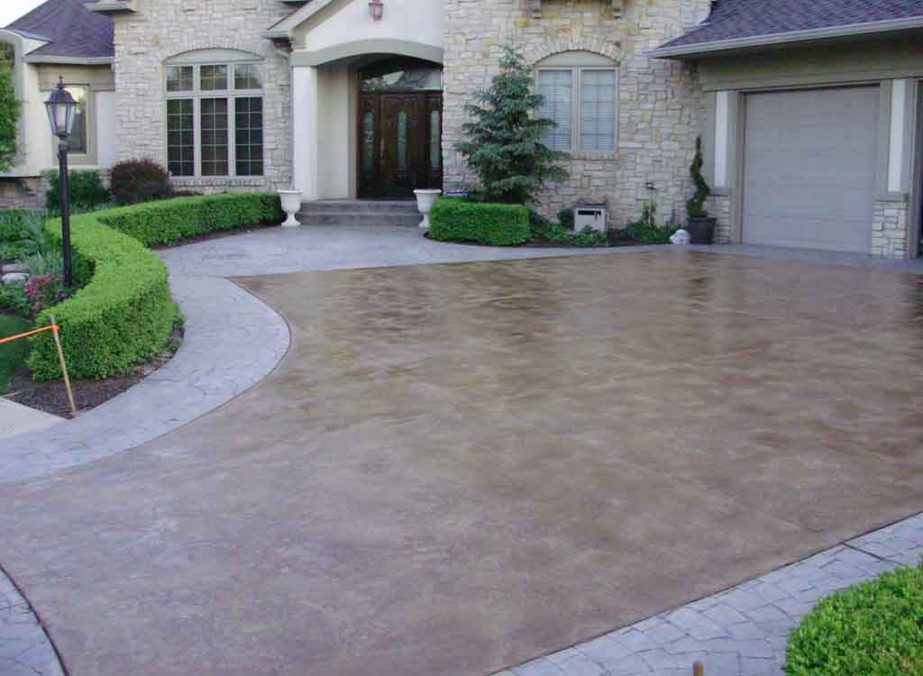 New pour concrete indy decorative concrete flatwork for Pouring concrete driveway